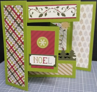 Inside of Noel card: Evergreens pop up from the bottom and a double star hangs from the top