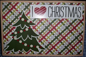 Plaid paper trimmed to 3.75x5.75 and attached to the front of a tan card; tree and I <3 Christmas stickers